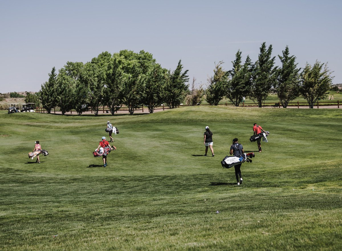 featured image of friends playing golf